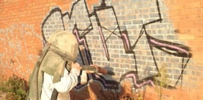 An image of Tyseley Industrial Park using shot blasting techniques to remove graffiti