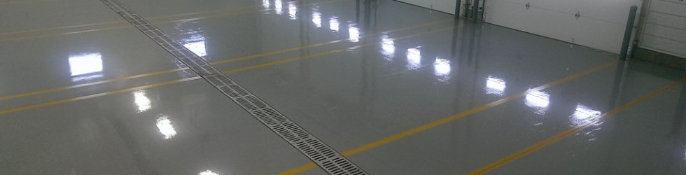 an image of the inside of a warehouse with epoxy flooring