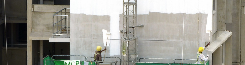 an image of a a commercial building being painted