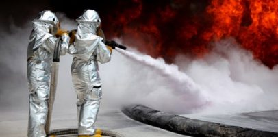 An image that shows two people extinguishing a fire.